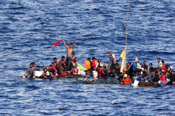 150610-M-ST621-140 MAKASSAR STRAIT (June 10, 2015) Distressed persons wait to be rescued by Sailors and Marines aboard the amphibious dock landing ship USS Rushmore (LSD 47) in the Pacific Ocean. Rushmore rescued 65 people after it was discovered they were floating on bamboo rafts tied together and with no means of propulsion. Once on board, the rescued individuals were provided food and medical attention by Marines and Sailors from the 15th Marine Expeditionary Unit and the Essex Amphibious Ready Group. (U.S. Marine Corps photo by Sgt. Emmanuel Ramos/Released)