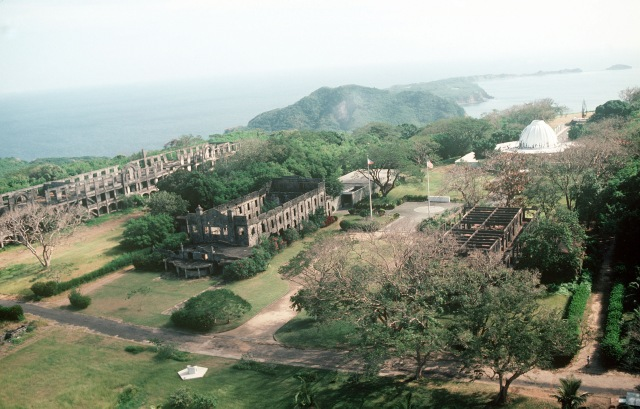 Aerial view of the ruins and a memorial to American defenders of the island during World War II.